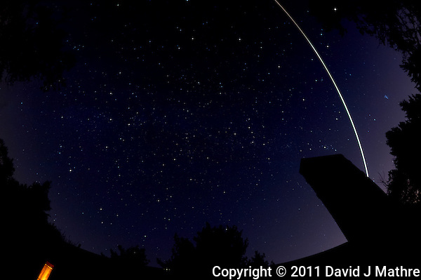 Late fall night sky over New Jersey with a Leonid Meteor. Image taken with a Nikon D3 and 16 mm f/2.8 fisheye lens (ISO 200, 16 mm, f/5.6, 60 sec). Raw image processed with Capture One Pro 6, Nik Define, Photoshop CS5. (David J Mathre)