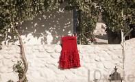 Red Flamenco skirt hangs to dry in the sun in Granada, Spain. (© Boianna / Loxarte)