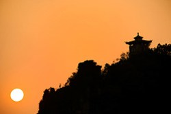 Pagoda on Xilang Hill silhouetted against sunset, Yangshuo, Guanxi, China
