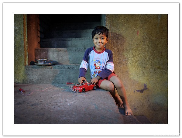 """The Boy with the Red Car"" - Chennai, India (© 2011 Ian Mylam)"