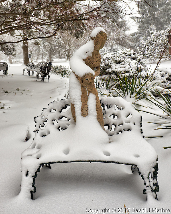 Birdbath statue standing on a bench covered with snow.  Image taken with a Fuji X-T1 camera and 16 mm f/1.4 lens (ISO 200, 16 mm, f/7, 1/125 sec). (David J Mathre)