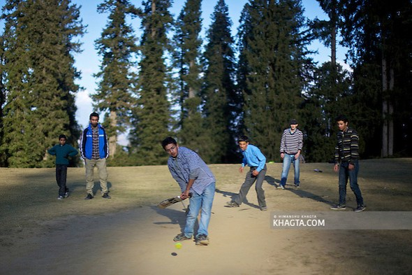 Youngsters playing cricket in a playground in a dense pine forest near Narkanda, Shimla.  The place gets covered with snow in winters and used for various skiing events. (Himanshu Khagta)