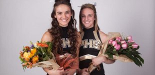 Graduating Senior Providence High School Cheerleaders pose with flowers.