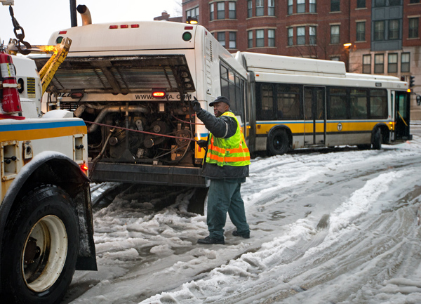 12/29/2015-Boston,MA. One of 5 MBTA elongated buses is freed from it's stuck position during Tuesday morning's snowfall. The buses, on Clarendon St. between Columbus and St. James, were stuck for approximately one hour. Staff photo by Mark Garfinkel