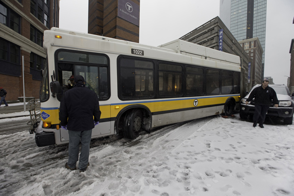 12/29/2015-Boston,MA. One of 5 MBTA elongated buses is seen stuck during Tuesday morning's snowfall. The buses, on Clarendon St. between Columbus and St. James, were stuck for approximately one hour. Staff photo by Mark Garfinkel