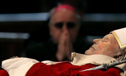 The body of Pope John Paul II lies in state in the Saint Peter's Basilica, 2005.
