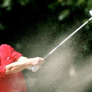 England's Paul Casey plays out of a bunker on the 16th hole during his finals of the World Match Play Championship against U.S. Shaun Micheel at the Wentworth Club in Virginia Water, southeast England, September 17, 2006.