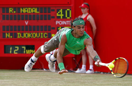 Rafael Nadal of Spain returns the ball to Serbia's Novak Djokovic during their singles final at the Artois tennis championships at Queen's Club in west London June 15, 2008.