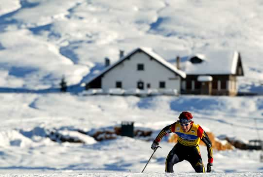 German Ronny Ackermann skis during the nordic combined Men's 15km cross-country race at the Nordic Combined skiing World Cup in Val di Fiemme December 12, 2003.