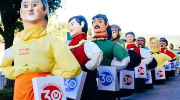 Higantes in SM tenants' uniforms getting ready for their parade.