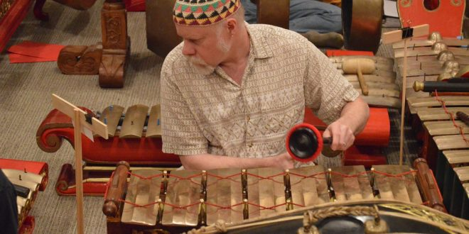 Students and community members practice on rare Javanese gamelan percussion set