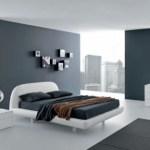 Dormitorio minimalista en blanco y gris