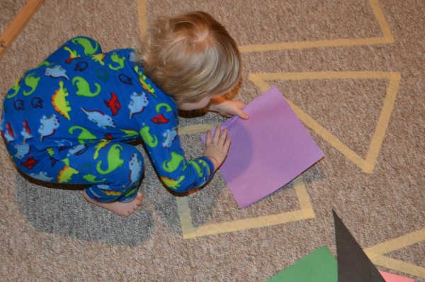 Practice shapes  and get the kids moving with this tape shapes game