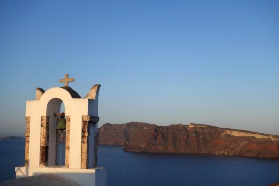 sunset santorini greece oia fira caldera aegean blue domes food black beach beer