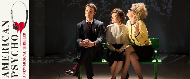 A scene from American Psycho the musical at the Almeida Theatre. The image shows Matt Smith in the lead role of Patrick Bateman sat on a green park bench with two secretaries. The stage set is blank with the exception of trees which appear as sketches drawn with light.