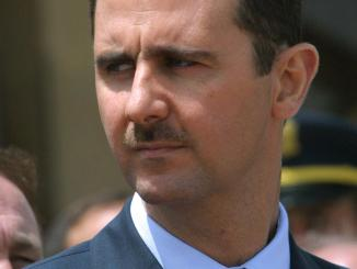 Syrian President Bashar al-Assad attends the depar