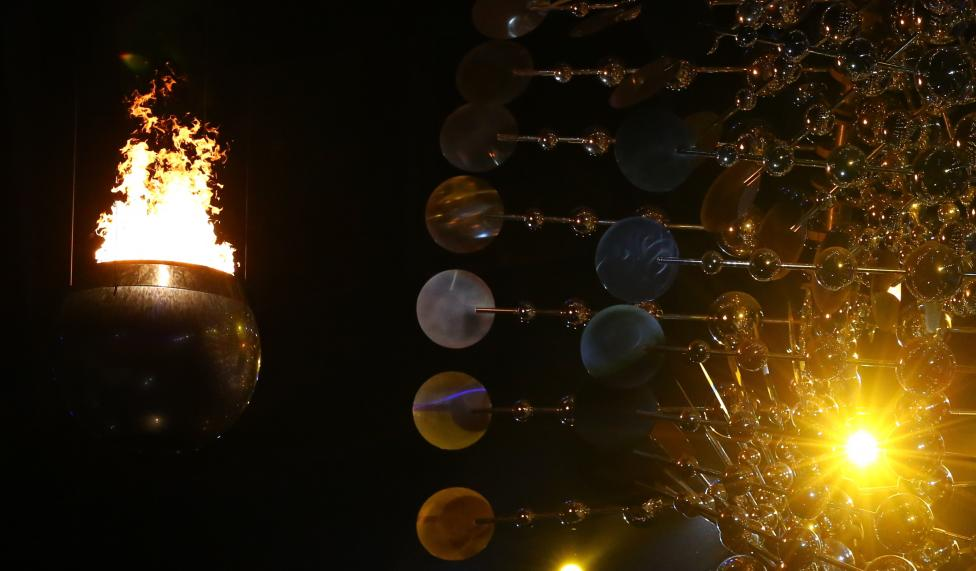 The Olympic Flame is seen lit. REUTERS/Ruben Sprich