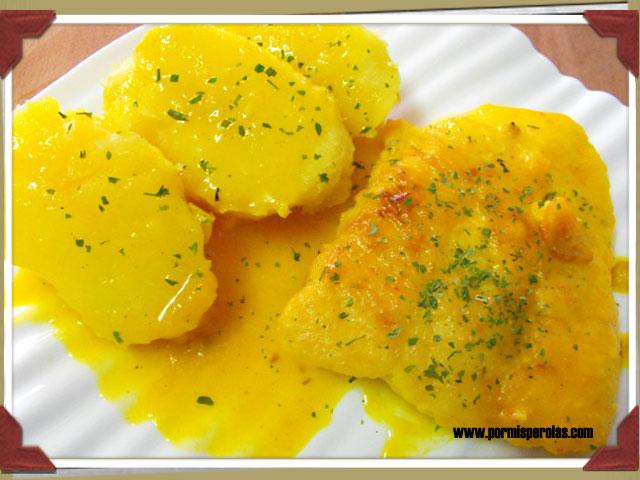 Merluza en salsa de naranja y azafrán