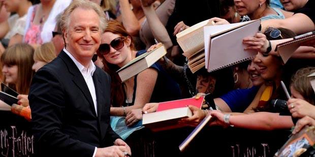 Alan Rickman signs autographs as he arri