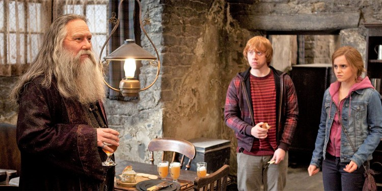 (L-r) CIARçN HINDS as ABERFORTH DUMBLEDORE, RUPERT GRINT as Ron Weasley and EMMA WATSON as Hermione Granger in Warner Bros. PicturesÕ fantasy adventure ÒHARRY POTTER AND THE DEATHLY HALLOWS Ð PART 2,Ó a Warner Bros. Pictures release.