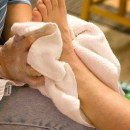 Homeless women receive foot massages from loving volunteers each week at our Burnside Shelter.