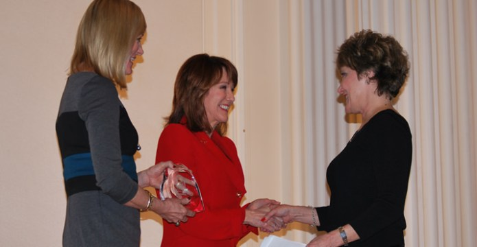 Priscilla Lewis. Executive Director for Community Services and Development at Providence Health & Services and KGW's Laurel Porter congratulate winner Terry Clelen. Terry won the Hands on Greater Portland Volunteer Award