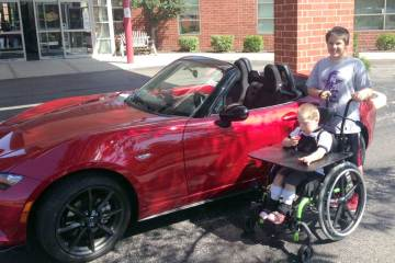 Five-year-old Scottie, the face of the New Wheels raffle, loves cars.