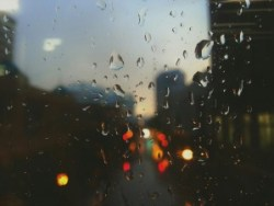 raindrops on a window with traffic in the background