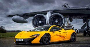 mclaren-p1-yellow-car-engine-fan-storm-grey-sky-wallpaper