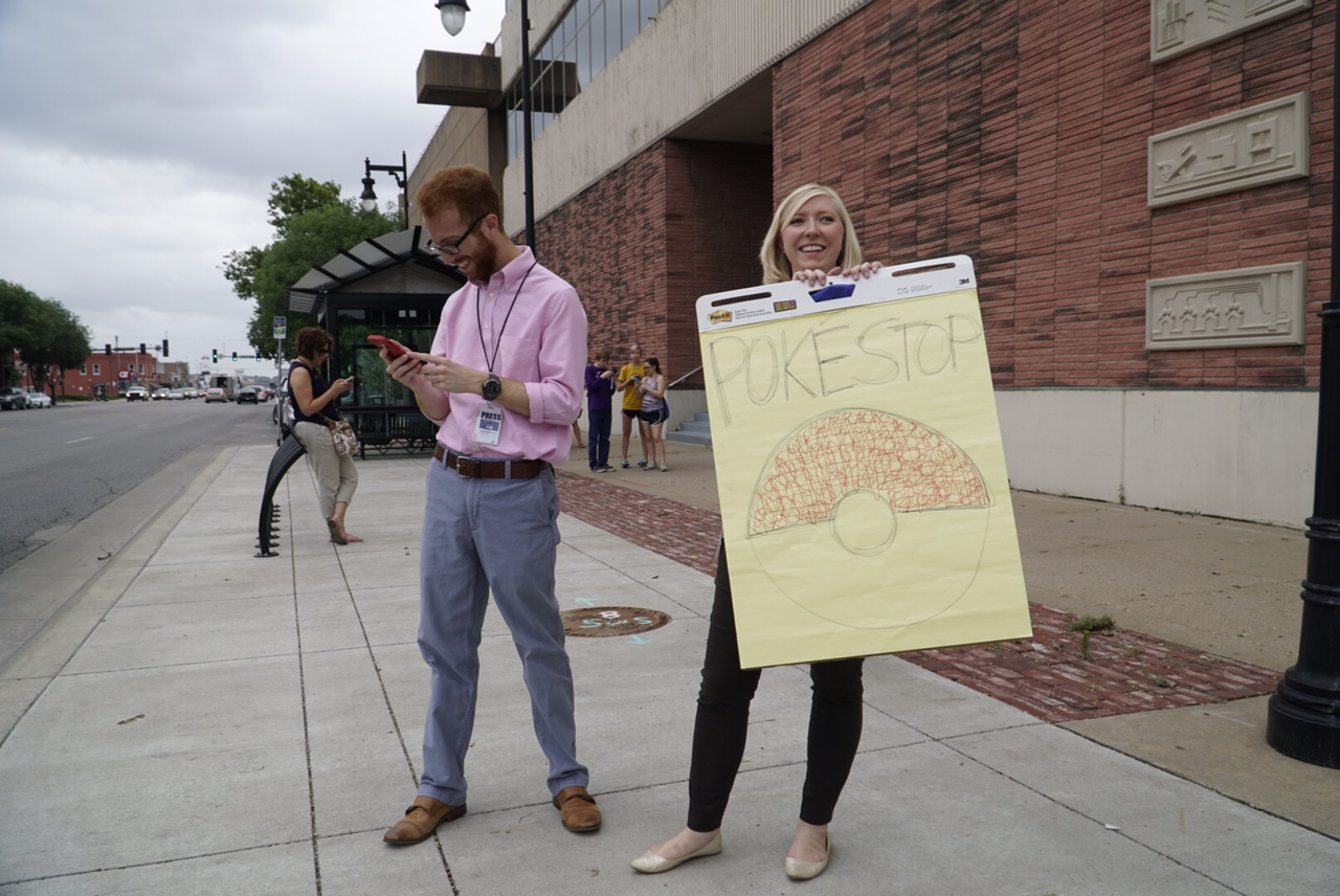 Wichita Eagle reporters Matt Riedl and Kelsey Ryan outside the paper on Tuesday trying to catch some engagement. (Photo by Jaime Green/Wichita Eagle)