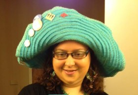 The big blue hat has become part of Michelle Minkoff's conference look. (Photo courtesy Michelle Minkoff)