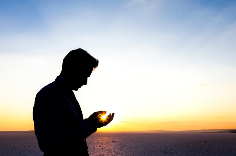Silhouette of a praying man