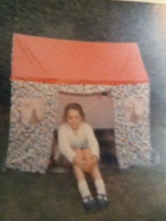 girl in wendy house illustrating article about childrens stories