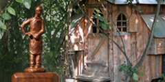 Circular chicken house and woodcarver
