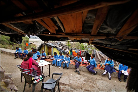Young Indian children study at an open air school in Jammu, India, Monday, April 16, 2012. A law making primary education compulsory in India came into effect, opening the door for millions of impoverished children who have never made it to school because their parents could not afford the fees or because they were forced to work instead. (AP Photo/Channi Anand)