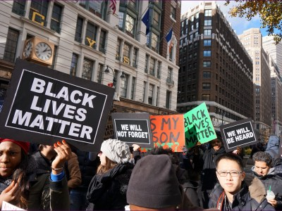 NYC action in solidarity with Ferguson. Missouri, encouraging a boycott of Black Friday Consumerism. (Photo by The All-Nite Images)