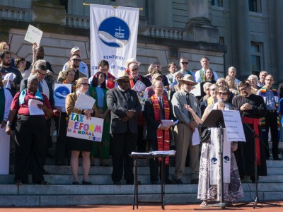 The Rev. Dr. Peggy Hinds, interim director of the Kentucky Council of Churches, speaks during 'Higher Ground Moral Day of Action' on the steps of the Kentucky State Capitol. (Photo by Gregg Brekke)
