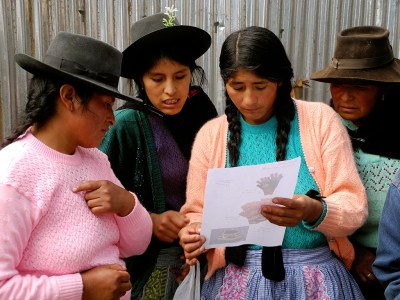 Artisans from the group Tupac Yupanki, which is supported by Partners for Just Trade, review an order. —Jessica Penner