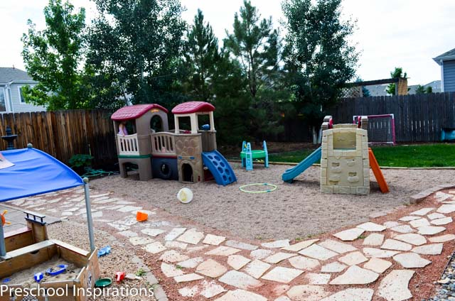 This is the outside play area for my in home preschool with climbers, a sand box, and grassy area. We also have a greenhouse.
