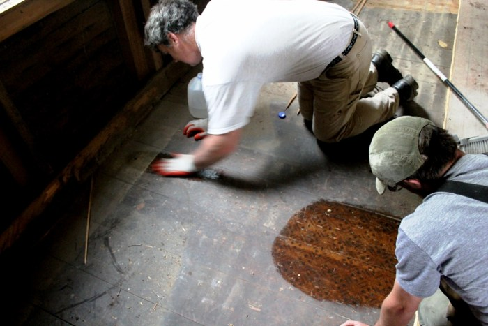Dan and Pete washing the Pink Parlor floor