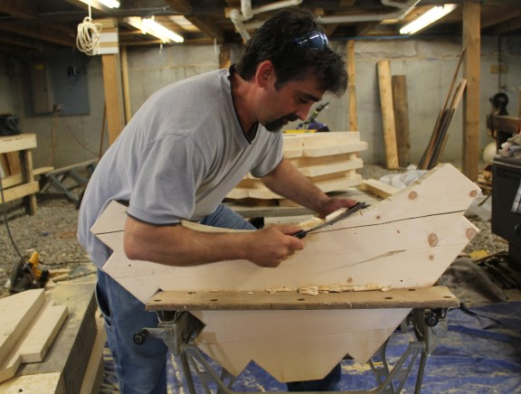 Keith using drawknife to smooth curved brace