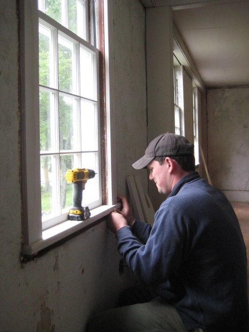 The author, installing window casing