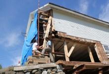 Lee, Chuck and Scott install a deadman under the barn's corner post
