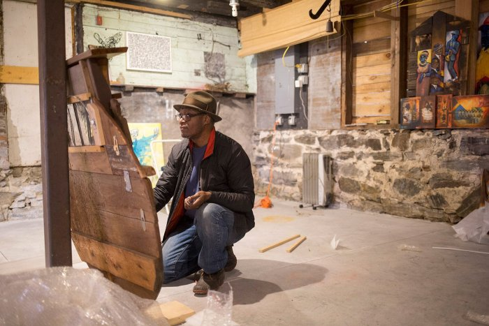 Daniel Minter installs 'A Distant Holla' at the Abyssinian. Photo courtesy Portland Press Herald, by staff photographer Brianna Soukup