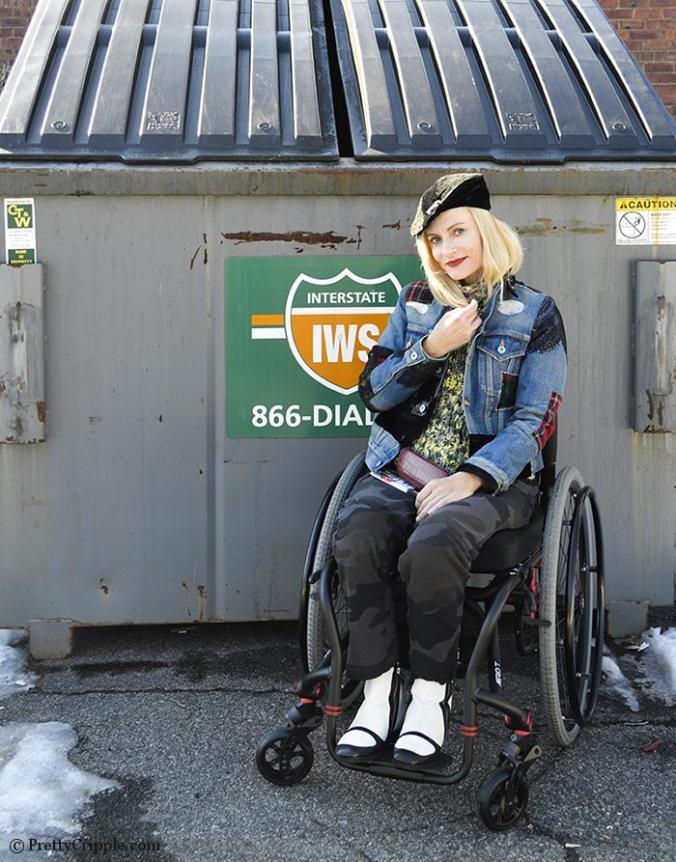 Wheelchair disabled fashion blogger PrettyCripple - Dumpster Diving for fashion week. Seen wearing a Junya Watanabe denim jacket.