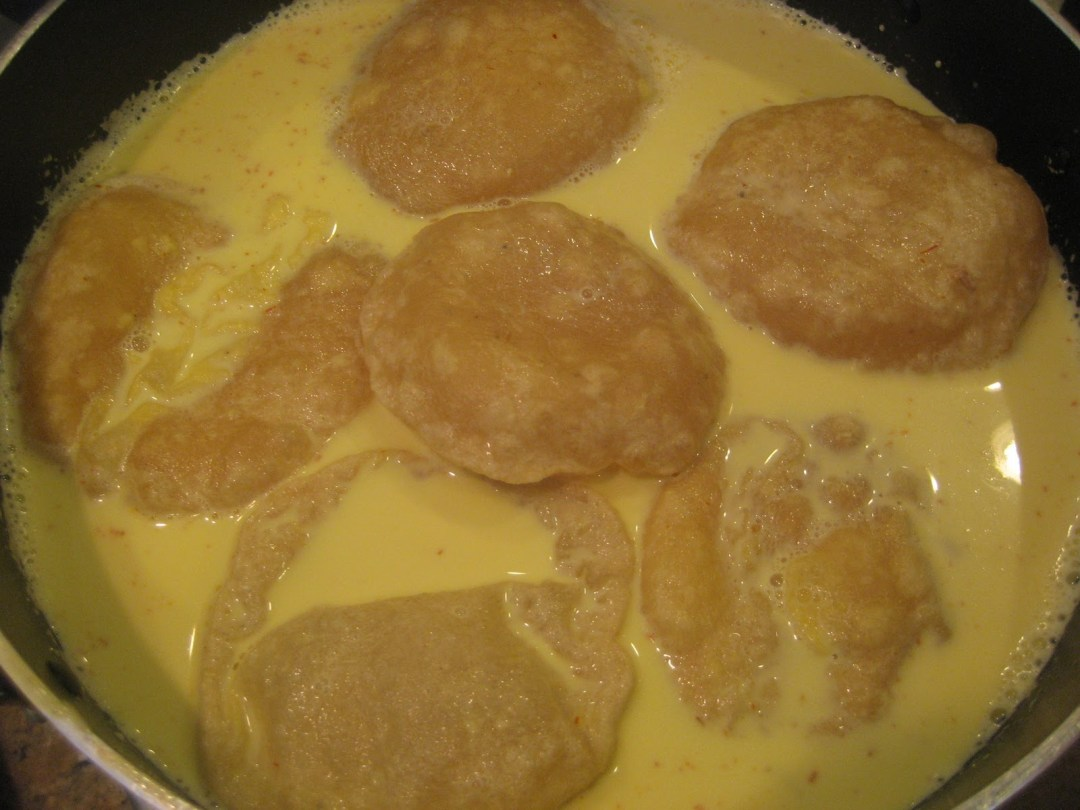 Paal Poli (Sweet pooris in sweet saffron milk)