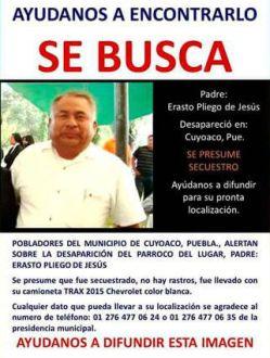 El cartel donde se reportaba la desaparición del sacerdote