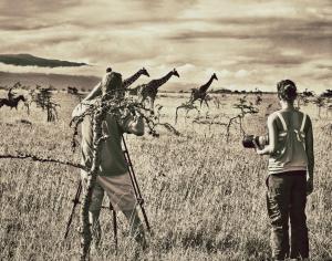 Dirk Collins filming giraffes in Kenya for OneEyedBird