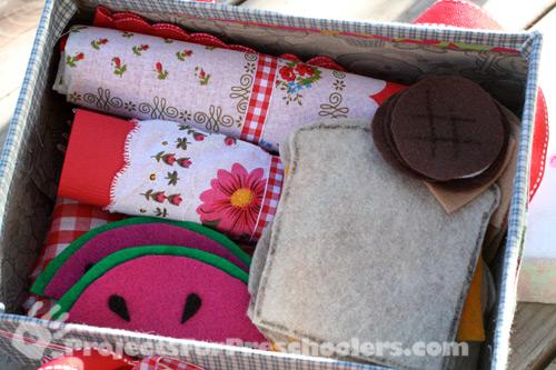 Store felt picnic food in shoebox picnic basket