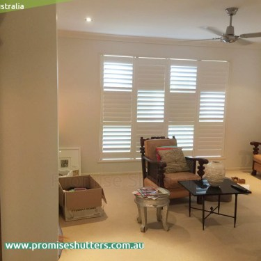 solid Vinyl window shutters installed by pivot hinges
